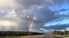 Triple rainbow from highway, Alberta Canada Stock Footage