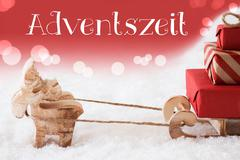 Reindeer With Sled, Red Background, Adventszeit Means Advent Season Stock Photos