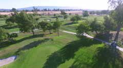 4k aerial view golf kart riding along course path Stock Footage