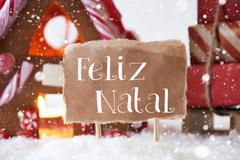 Gingerbread House With Sled, Snowflakes, Feliz Natal Means Merry Christmas Stock Photos