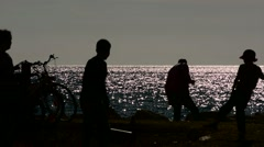 Crowd of people in the sea at sunset Stock Footage
