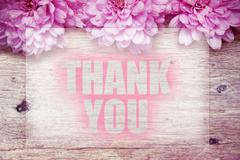Pink flowers on wooden with word Thank you Stock Photos