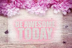 Pink flowers on wooden with word Be awesome today Stock Photos