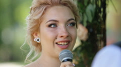 Beautiful blonde bride with nose ring taking vows at wedding ceremony Stock Footage