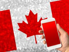 Canada flag on bokeh background with copy space on smartphone Stock Photos