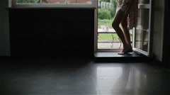 Woman in night pajamas barefoot standing at the balcony open doors . Stock Footage