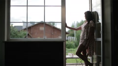 Woman in night pajamas barefoot standing at the balcony open door. Stock Footage
