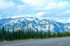 Mountain and trees on the road trip, national park background Stock Photos
