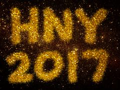 gold glitter abstract background with word HNY 2017 - stock photo