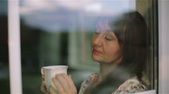 Thoughtful sad brunette woman outside drinking warm morning tea and  dreaming. - stock footage