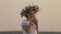 Young beautiful girl is drinking milk from a jug on the nature Stock Footage