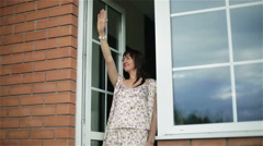 Happy brunette awakened middle aged woman in pajamas on the balcony. - stock footage