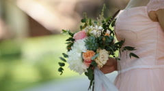 Side view of beautiful smiling young blond woman in the park with bouquet on a Stock Footage