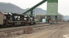 Train pulls up to filling station with coal cars (HD) - stock footage