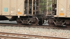 Two train cars go slowly along rails with focus on wheels (HD) - stock footage
