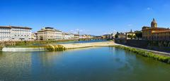 Florence or Firenze panoramic view of Arno river and Carraia medieval bridge. Stock Photos