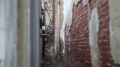 Tracking Shot of small alleyway between two old buildings (HD) - stock footage