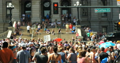 4K People marching with Rainbow flags Gay Pride Parade Colfax Denver Stock Footage