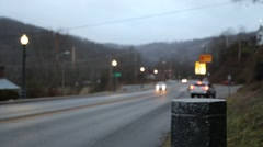 Soft Focus of small town road and stop light (HD) - stock footage