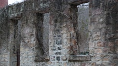 Pan down vine covered wall of ruined coal mill (HD) - stock footage