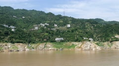 Three Gorges Dam houses on hill sides Stock Footage