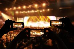 Take photo crowd in front of concert stage blurred - stock photo