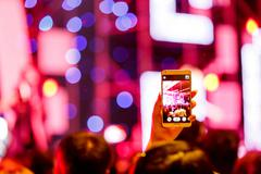 Take photo crowd in front of concert stage - stock photo
