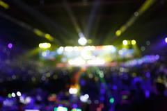silhouette concert in front of stage blurred - stock photo