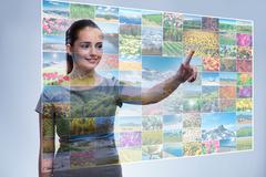 Businesswoman pressing virtual button on nature collage Stock Photos