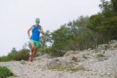 Caucasian man running at Mount Daibosatsu, Yamanashi Prefecture, Japan - stock photo