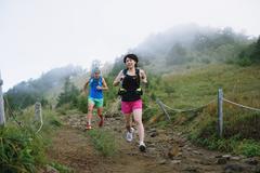 Trail runners at Mount Daibosatsu, Yamanashi Prefecture, Japan - stock photo