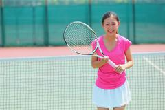 Young Japanese tennis player in action - stock photo
