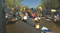 DOF: Heart shaped padlocks locked on old bridge as sign of love and friendship Stock Footage