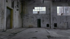 Pan shot of an empty boiler room of a run-down, abandoned factory. Stock Footage
