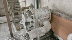 A close up shot of old broken boiler room equipment in an abandoned factory. Stock Footage