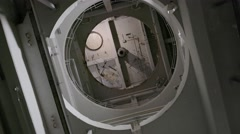 A spinning shot, looking up a round shaft in an abandoned factory. Stock Footage