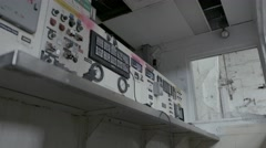 A still shot of a run-down control panel in an abandoned factory. A broken, Stock Footage
