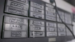 A rack focus from the labels in the front to those in the back on a control Stock Footage