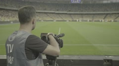 The cameraman shoots the news on the stadium Stock Footage