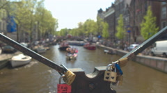 DOF: Colorful lovelocks on old bridge as sign of eternal love and commitment Stock Footage