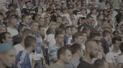 A crowd of fans at the stadium sing the song during the match Stock Footage