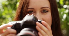 4k, young photographer takes a photo with her digital camera. Slow motion. - stock footage