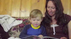Mom reads to child Stock Footage