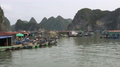 Floating fishing village nearby Ha Long Bay, Vietnam. Tracking shot. Stock Footage