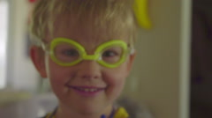 Portrait of ridiculous kid in goggles Stock Footage