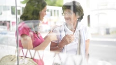 Senior woman with home carer waiting for the bus Stock Footage