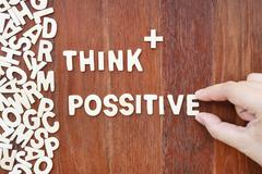 Word think possitive  made with block wooden letters Stock Photos