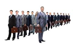 Long queue of businesspeople with their briefcase Stock Photos