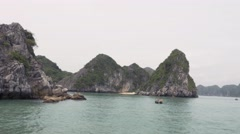 Passing by the limestone rocks of Ha Long Bay, Vietnam. Tracking shot Stock Footage