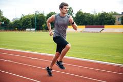 Sprinter running on athletics tracks Stock Photos